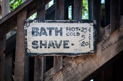Antique sign for a shave.
