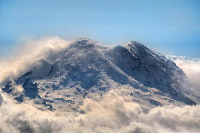 Mountain rising about the clouds.